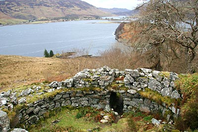 The broch peers across Loch Duich from its elevated position